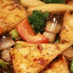 HUNAN TOFU - SPICY FIRM TOFU WITH STRAW MUSHROOMS, SNOW PEAS, BROCCOLI, BABY CORN & RED BELL PEPPERS.